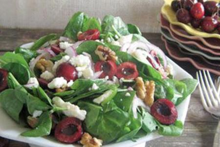 Cherry, feta cheese and walnut spinach salad
