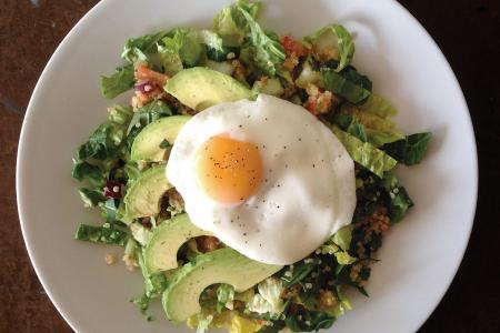 Mexican quinoa salad with fried egg