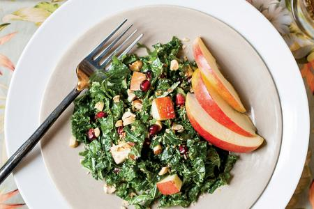 Kale and apple salad with orange-coconut yogurt dressing