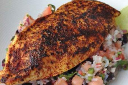 Rocco's chili-rubbed chicken with black bean salsa and rice